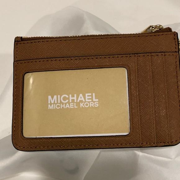 c290eccb0d14c MK Jet Set leather coin pouch with ID window. M 5bda8f545c4452f0155aa826
